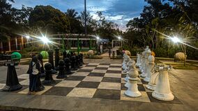 a big chess board in midle of park