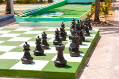 Big chess board and chess on the street, Cayo Largo, Cuba. Big chess board and chess on the street, Cayo Largo, Cuba Royalty Free Stock Images