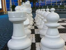 Big chess board white figures game backdrop. White chess figures concept strategy no people Stock Photos