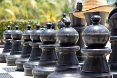 Big chess for game on a beach Stock Photos