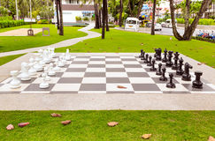 Big chess on green lawn in sunny day, Thailand Stock Photography