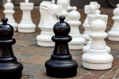 Big chess in a public square black and white. Big chess in a public square Royalty Free Stock Image