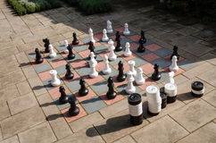Big chessboard. And checkers in a scottish garden Royalty Free Stock Photography