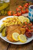 Big Chicken schnitzel with homemade chilli french fries Stock Photography