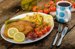Big Chicken schnitzel with homemade chilli french fries Royalty Free Stock Image