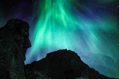 Big chief and the green lady. People from all over the world are dreaming of experiencing nature`s own fireworks on the Arctic sky. And few places on earth can Stock Photo