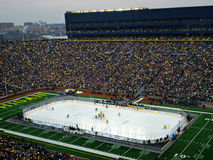 The Big Chill at the Big House Opening Face off. Opening face off of The Big Chill at the Big House outdoor hockey game between Michigan and Michigan State at Royalty Free Stock Photo