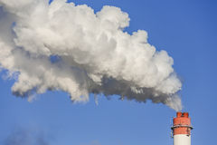 Big chimney with dramatic clouds of smoke. Stock Images