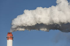 Big chimneys with dramatic clouds of smoke. Stock Photography