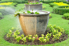 Big Chinese plant pots in public garden,  being water the plants Royalty Free Stock Images
