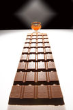 Big chocolate. And wine-glass with liquor, are photographed in the form chocolate road stock photo