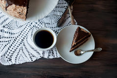 Big chocolate cake with chocolate frosting Stock Images