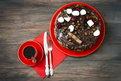 Big chocolate cake with chocolate frosting Royalty Free Stock Photos