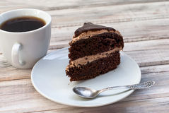 Big chocolate cake with chocolate frosting Royalty Free Stock Images