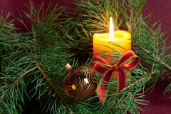 Big Christmas  baubles and candles on dark Royalty Free Stock Photos