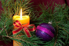 Big Christmas  baubles and candles on dark Stock Photo