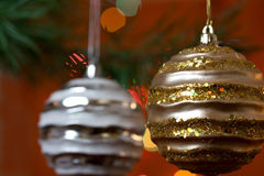Big Christmas baubles and fir branches Stock Images