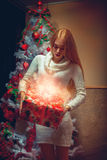 Big Christmas gift for the charming girl. Christmas mood. New Year Stock Photos