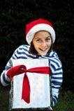 A big christmas present. Portrait of girl with big present Stock Image