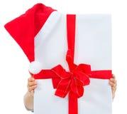 Big Christmas present box with Santa hat Stock Photos