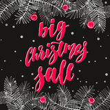 Big Christmas Sale. Holiday card with calligraphy, fir branches, berries and holly. Handwritten modern lettering banner on chalkboard dark background Stock Images