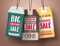 Big Christmas sale vector paper price tags hanging with different colors. And discount text for christmas holiday promotion. Vector illustration Stock Photos