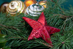 Big Christmas star ,baubles and fir branches Stock Photos