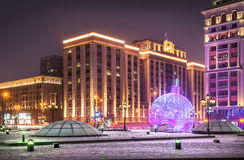 Big Christmas toy. Large illuminated Christmas toy lying in front of the State Duma in Moscow Royalty Free Stock Photos