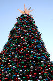 Big Christmas tree. A large decorated christmas tree outdoors Royalty Free Stock Image