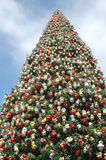 Big Christmas Tree 2. A very big Christmas tree with blue sky and clouds Royalty Free Stock Image