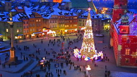 Big Christmas tree sparkling at Castle Square in Warsaw, Poland stock video footage