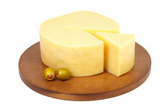 Big chunk of cheese with green olives. Stock Photos