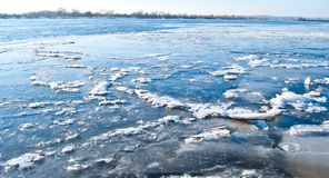 big chunk of ice on frozen river Stock Photo