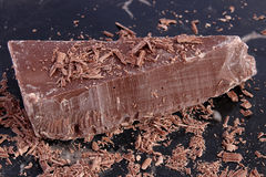 Big chunk of milk chocolate and shavings Stock Image