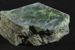 A big chunk of raw jade. Rouch cut jade sample with fresh saw marks Stock Photography