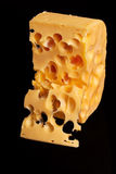 Big chunk of swiss yellow cheese. Stock Photography