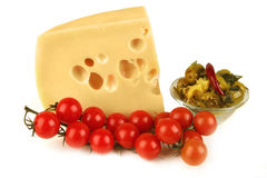 Big chunk of yellow cheese with olives Stock Images