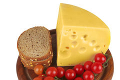 Big chunk of yellow cheese with tomatoes and bread Stock Photography