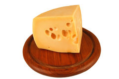 Big chunk of yellow cheese on wood Stock Photography