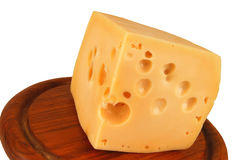 Big chunk of yellow cheese on wood Royalty Free Stock Photos