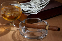 Big cigar and dollars Royalty Free Stock Photography