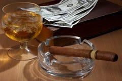 Big cigar and dollars Royalty Free Stock Photography