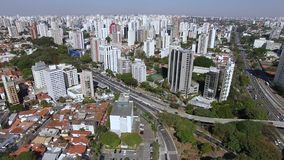 Big cities with traffic and buildings. Aerial view of highway and overpass in city. Top view city traffic of highway and bridge, logistics. Sao Paulo city stock video