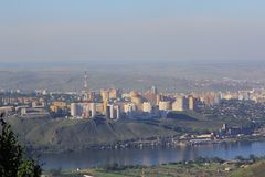 Big city on a hill on the banks of the mighty river Royalty Free Stock Photography
