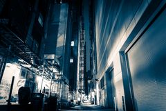 Big City Alley at Night. American Downtown Alley After Dark. Blue Color Grading stock photos