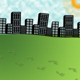 Big city and foot steps on green grass Stock Photo