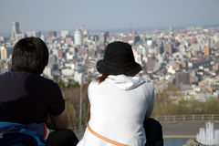 Big city life. Big city at their feet Stock Image