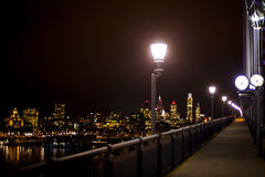 Big city lights. Lamp post with a street light on a illuminated city background Stock Photo