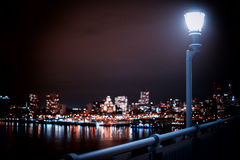 Big city lights. Lamp post with a street light on a illuminated city background Royalty Free Stock Photography