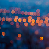 Big city lights in the twilight evening with blurring background Stock Images